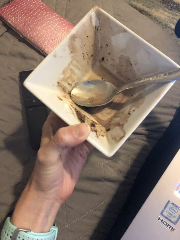 Empty white bowl of ice cream on the couch