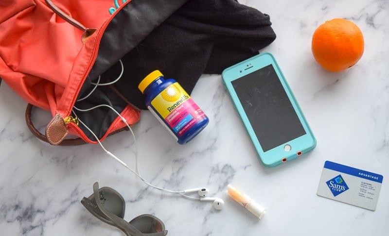 bag with probiotics, phone, fruit and headphones