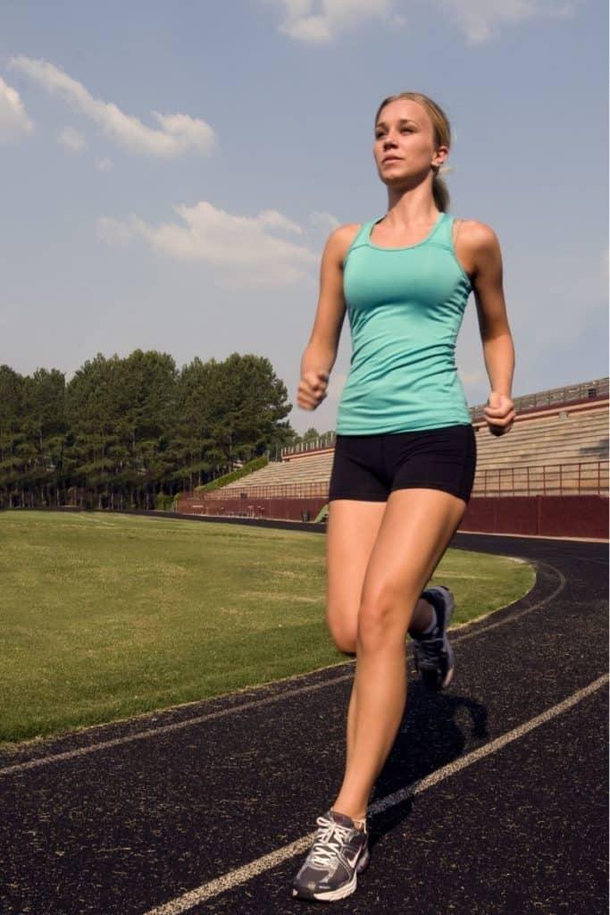 Girl running around a track | Bucket List Tummy