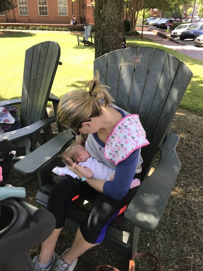Mom nursing baby on chair outside