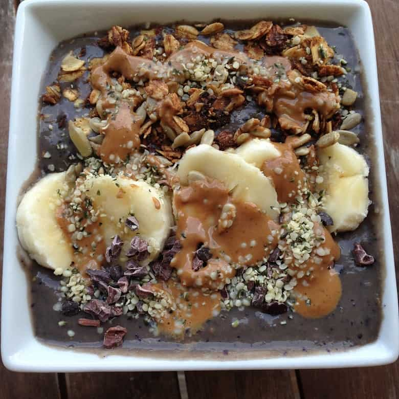 Smoothie bowl with fruit, granola and peanut butter, an example of a post run meal