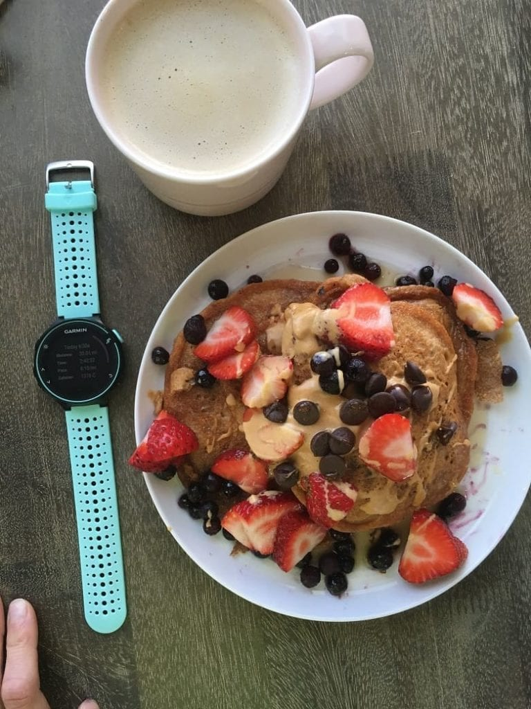 Kodiak Cakes with fruit and peanut butter with running watch