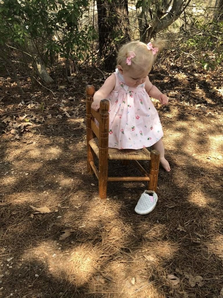 one year old sitting on wooden chair