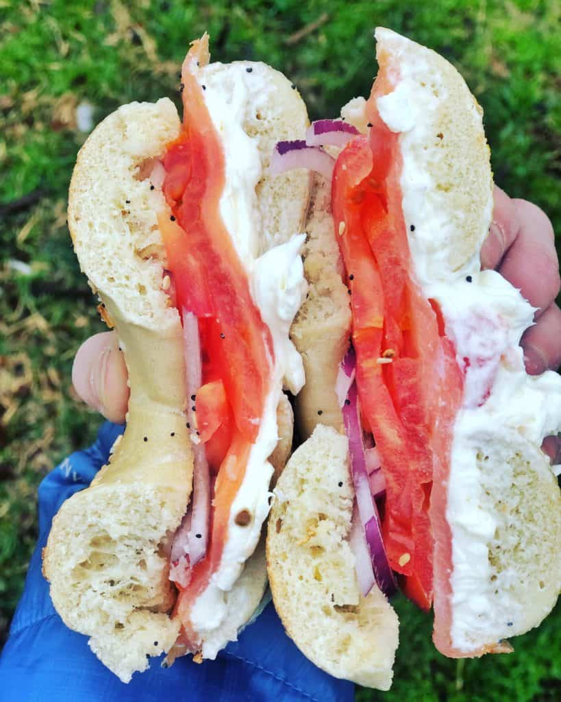 Bagel with salmon, cream cheese and tomatoes
