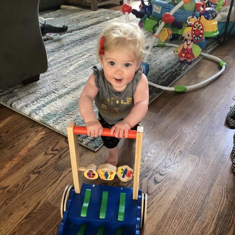 baby pushing a walker stroller