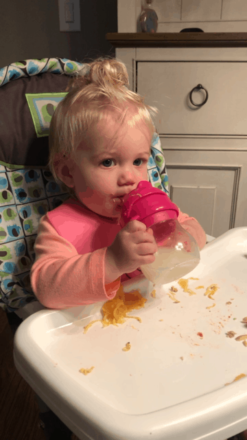 Baby drinking out of Oxo Tot Transition Sippy Cup