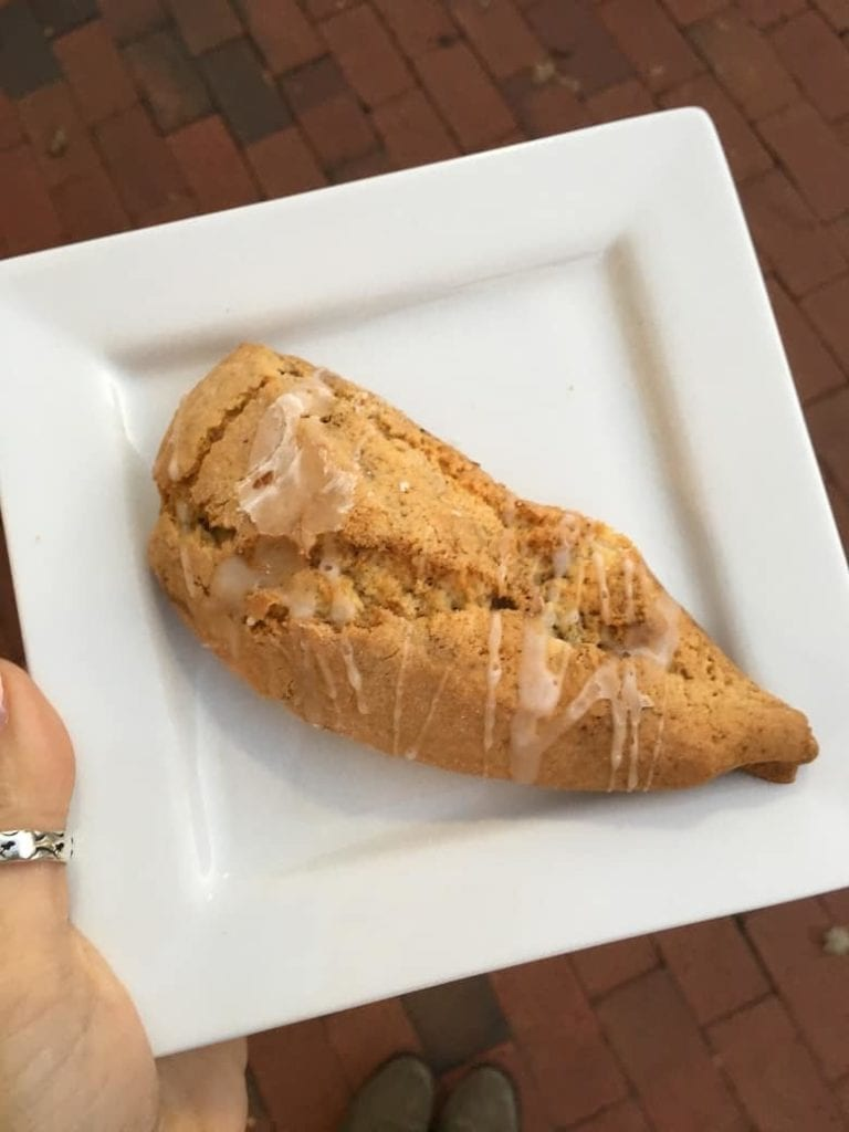 pumpkin glazed scone on white plate