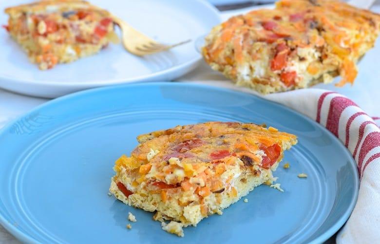 piece of sweet potato egg casserole on blue dish