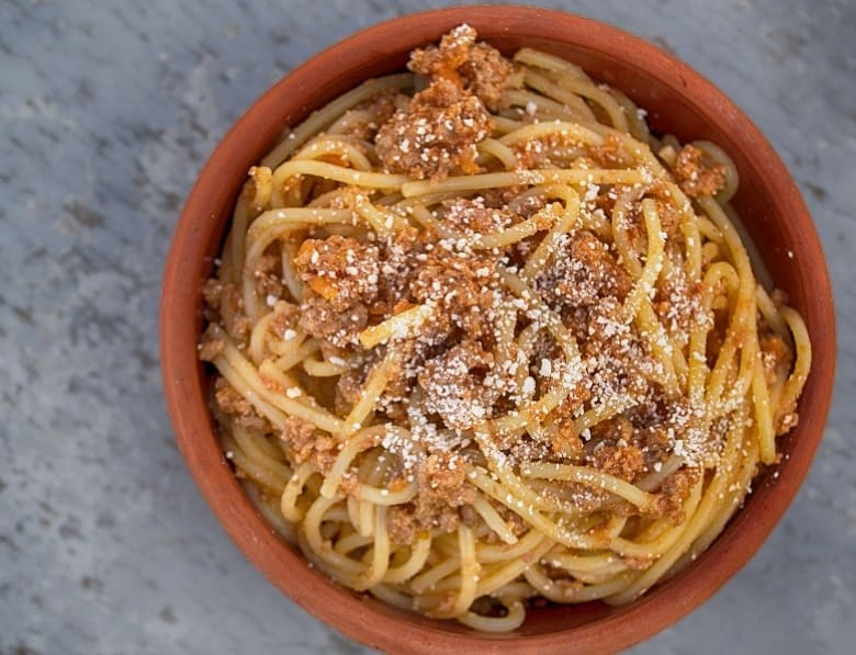 Bowl of pasta with meat and cheese