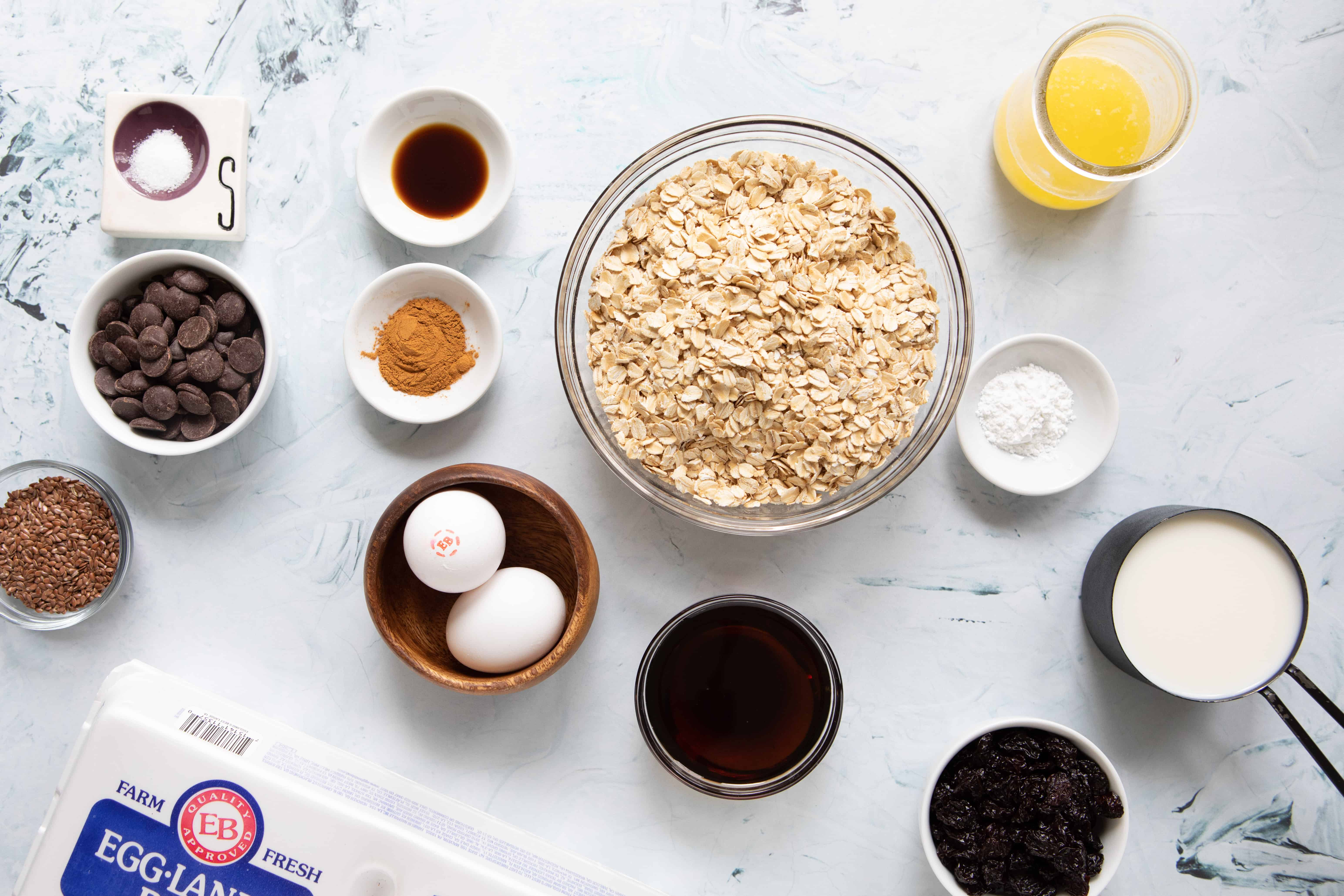 Mixing bowl with rolled oats and ingredients to make baked oatmeal cups
