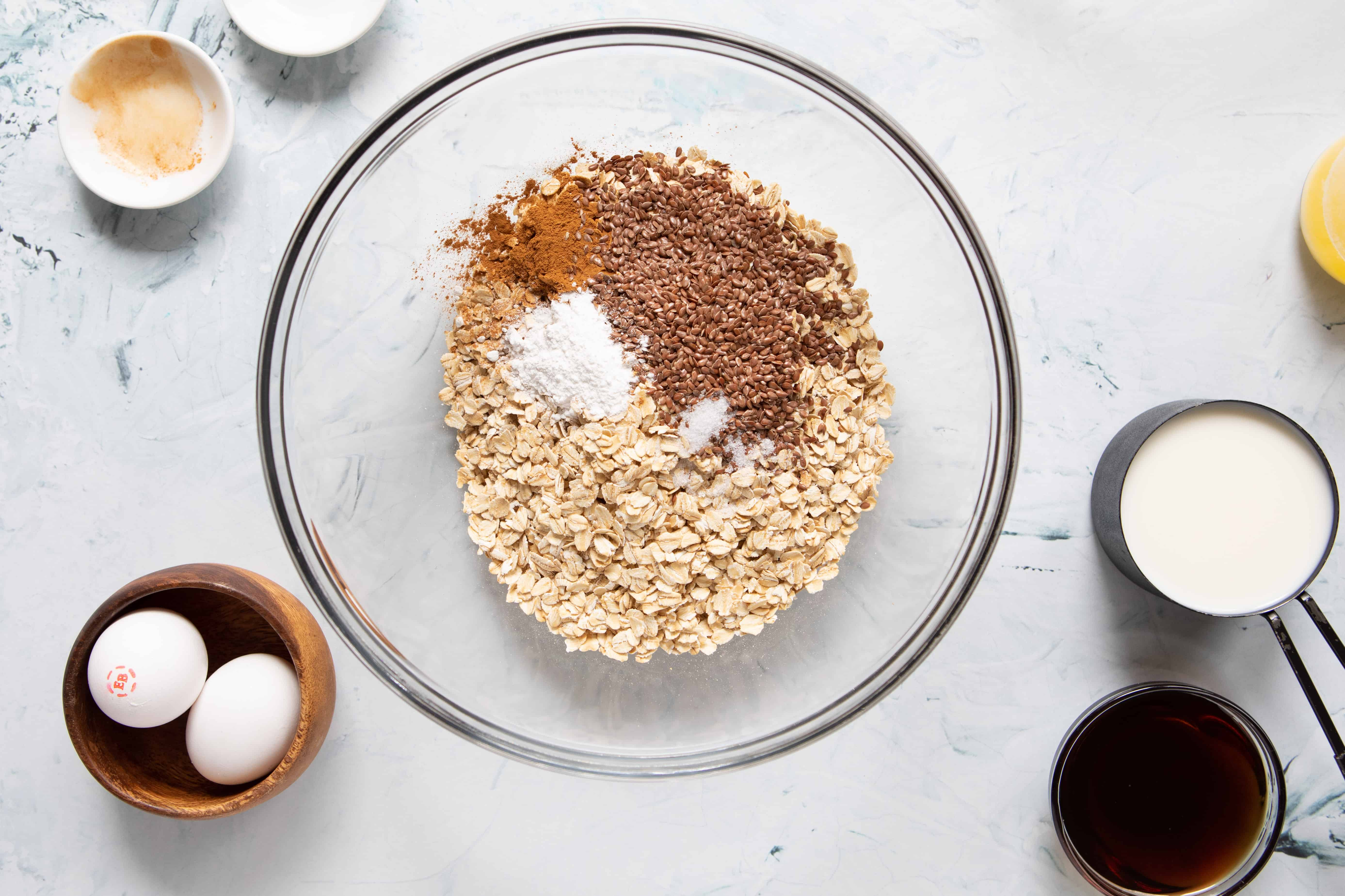 Mixing bowl with dry ingredients for cherry chocolate oatmeal cups