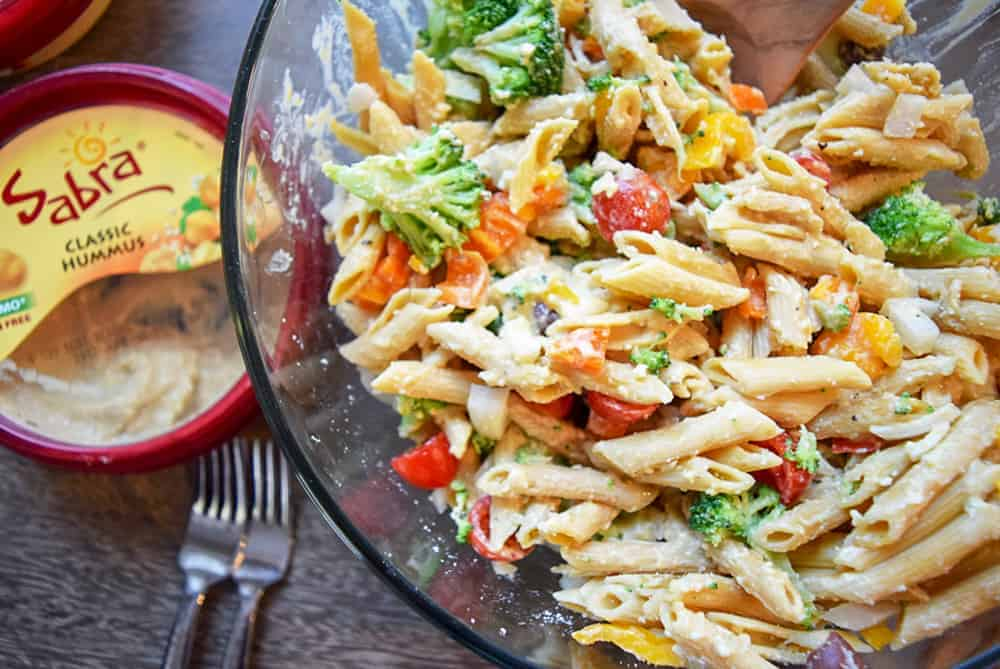Close up of Pasta salad made with hummus and vegetables