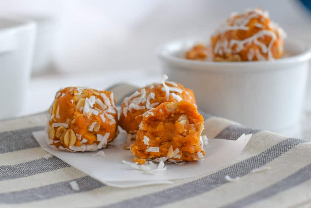 Closeup of sweet potato energy bites with coconut flakes