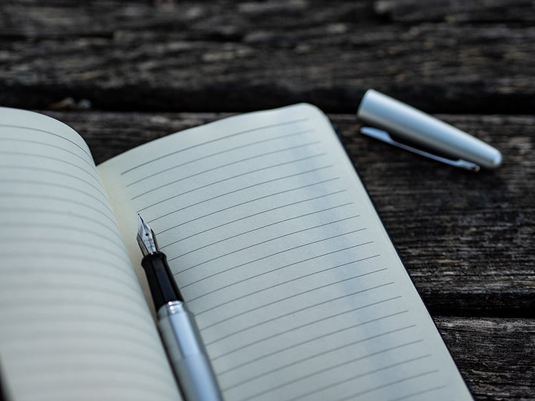 Empty notebook with pen