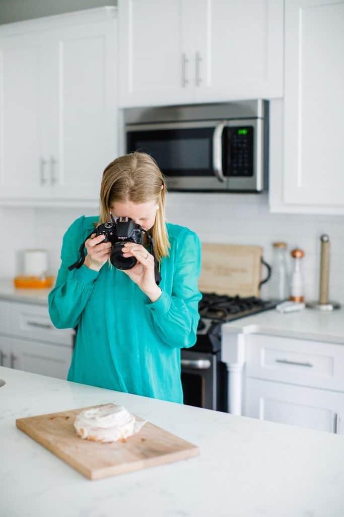 Registered Dietitian Entrepreneur taking picture of food