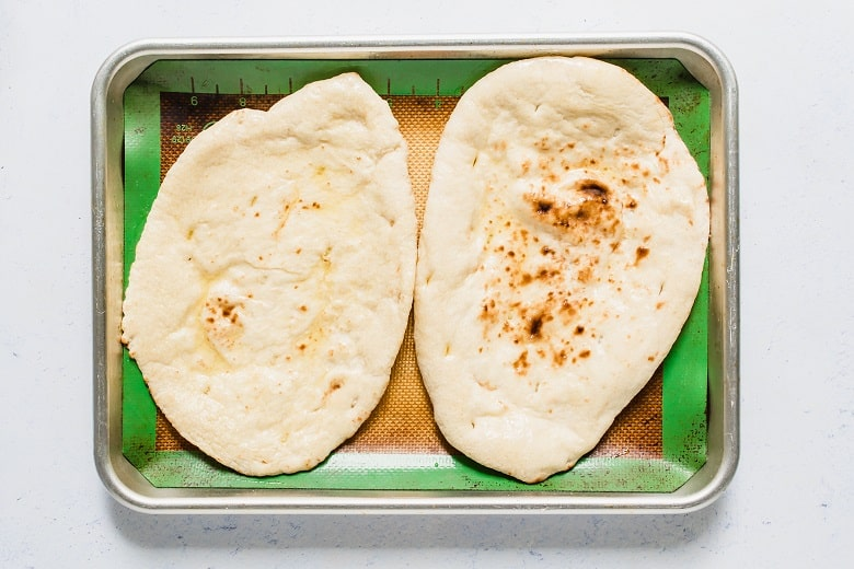 Naan bread on baking dish