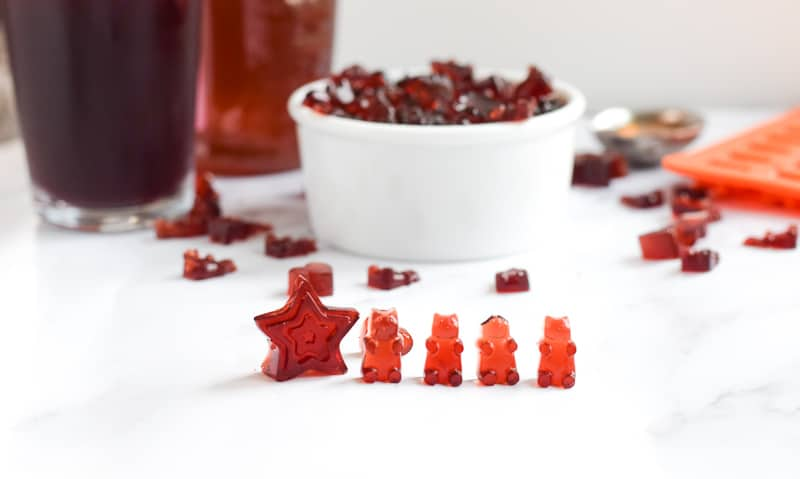 Tart Cherry Gummies on white countertop with more gummies in the background