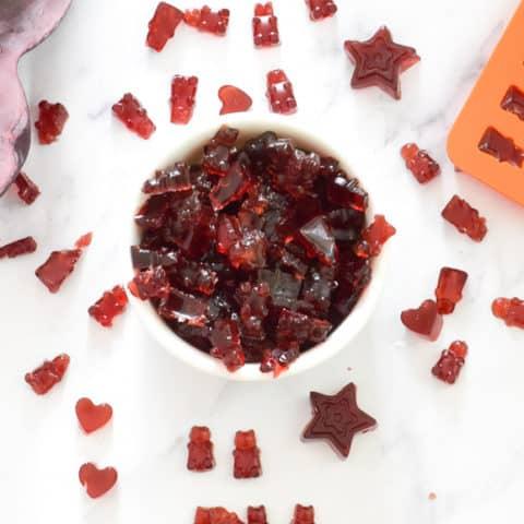 Tart cherry gummies on white bowl
