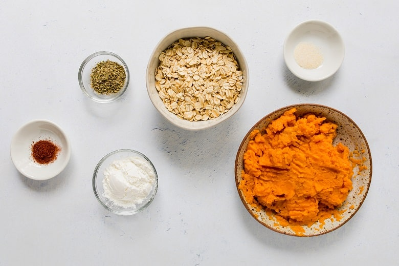 Mashed sweet potato with bowl of oats and spices