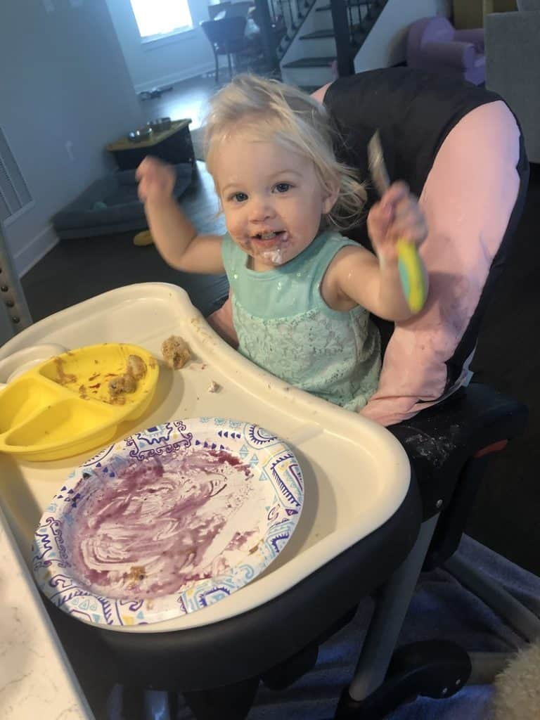 Toddler holding fork up with baby led weaning | Bucket List Tummy