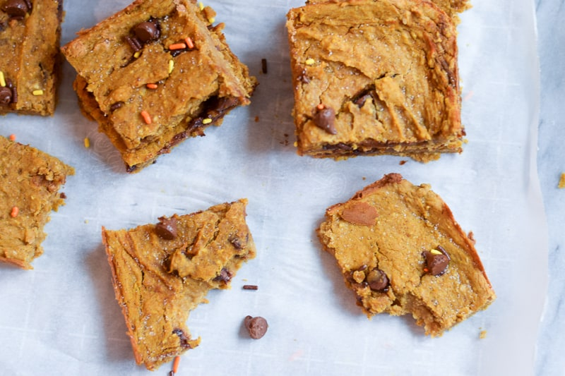 Overhead view of healthy pumpkin bars on parchment paper