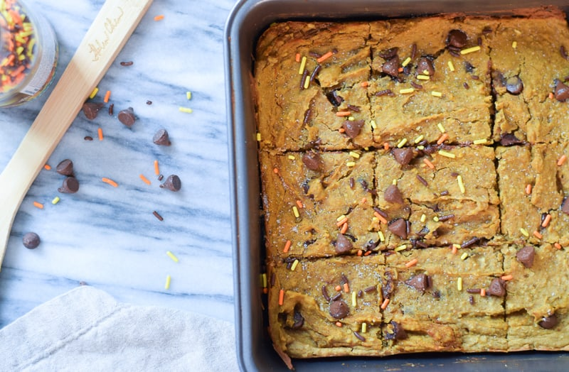 Closeup of pumpkin blondies in baking pan with sprinkles and chocolate chips