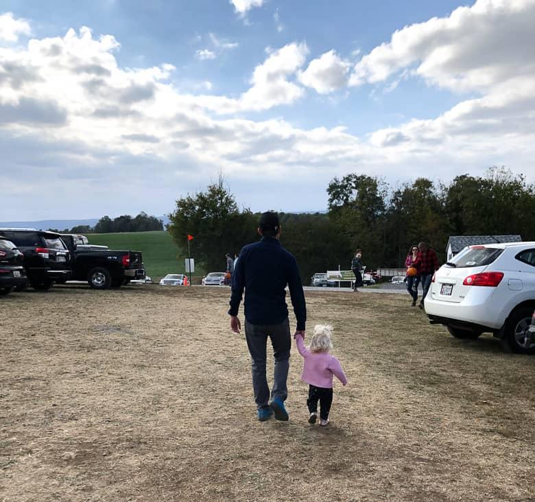 toddler walking with dad