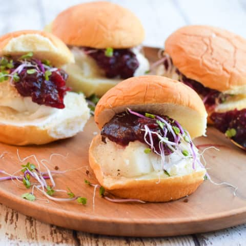 Alaska cod sliders with cranberry churney on brown serving board