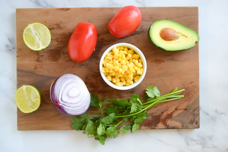 Ingredients for Avocado Tomato Salsa on cutting board