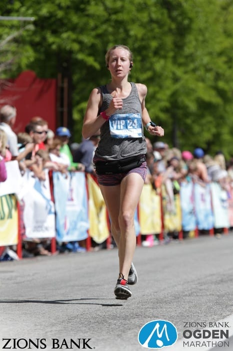 girl crossing finish line at Ogden Marathon in Utah