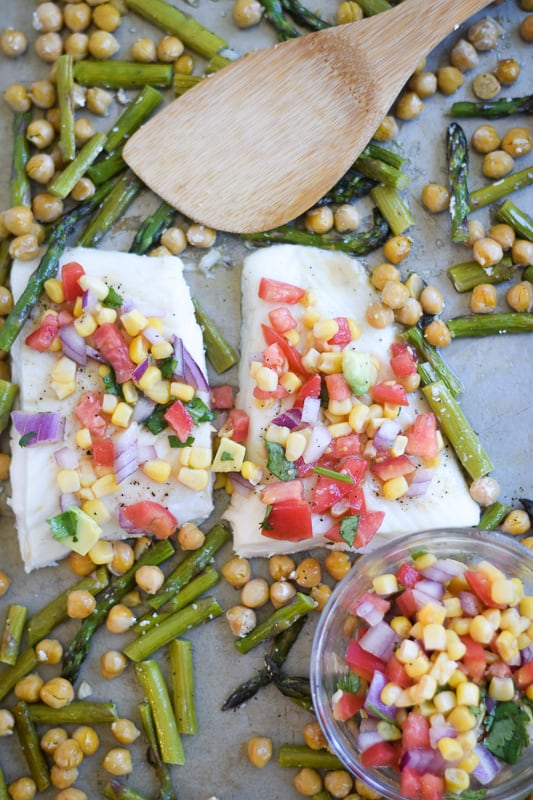 Alaskan Halibut on Sheet Pan with Chickpeas and Asparagus topped with avocado tomato corn salsa