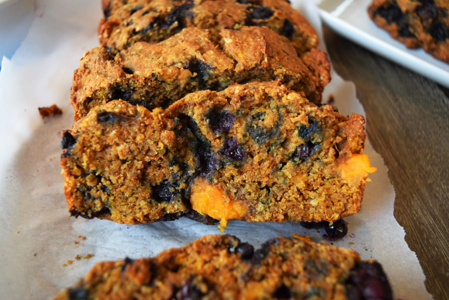 Sweet potato quick bread with blueberries on serving platter | Bucket List Tummy