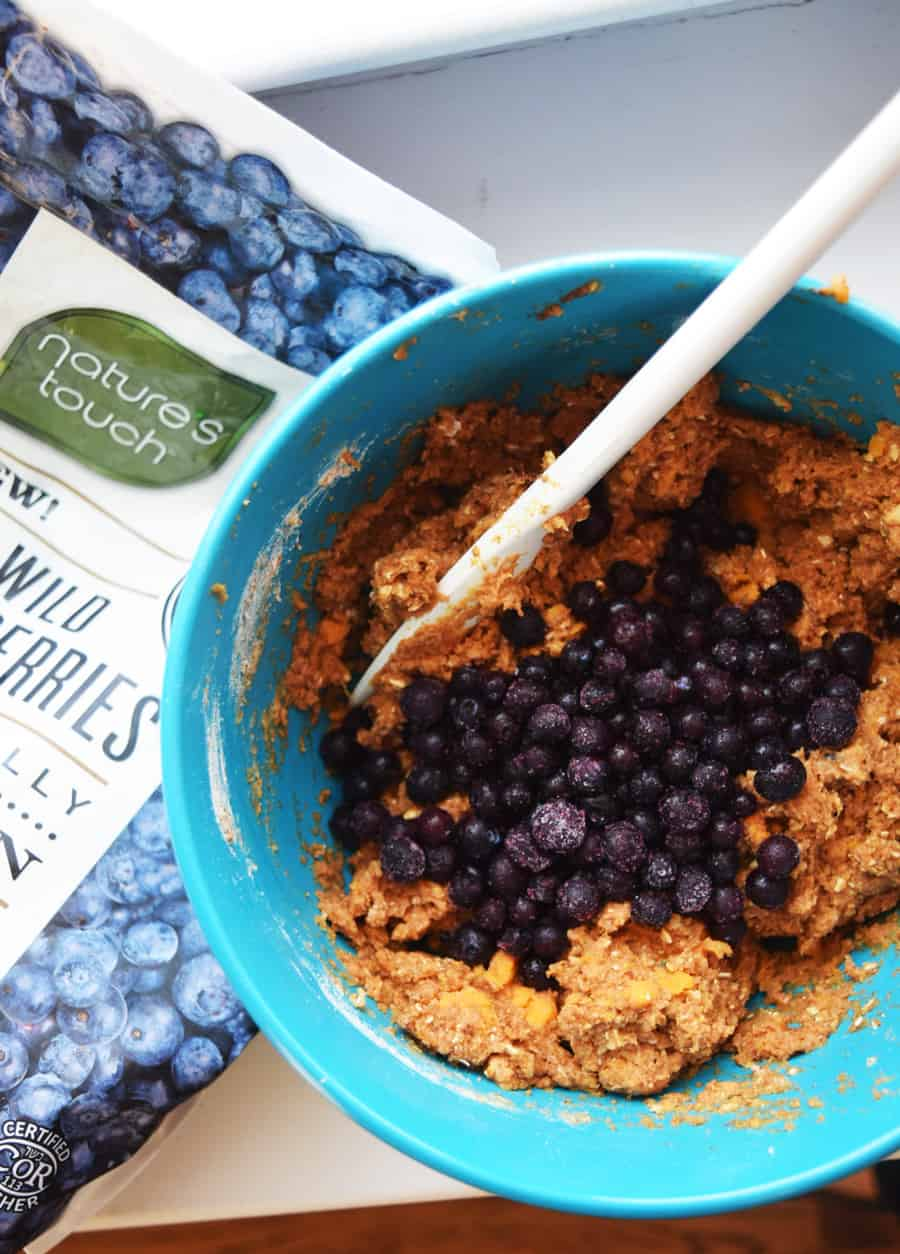 Bowl of sweet potato bread batter with frozen wild blueberries | Bucket List Tummy
