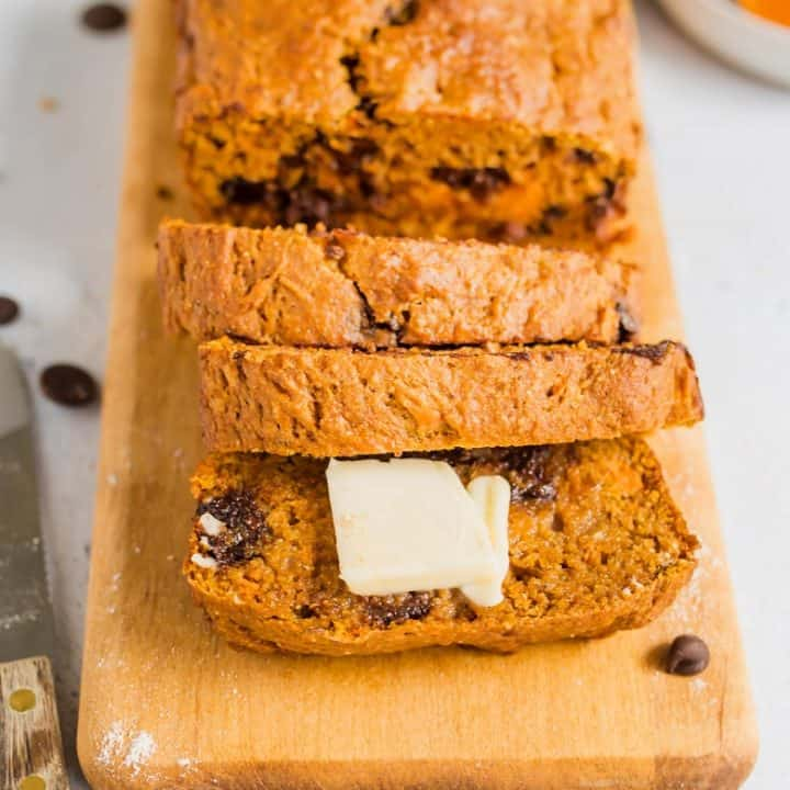 loaf of chocolate chip sweet potato bread with butter on front slice