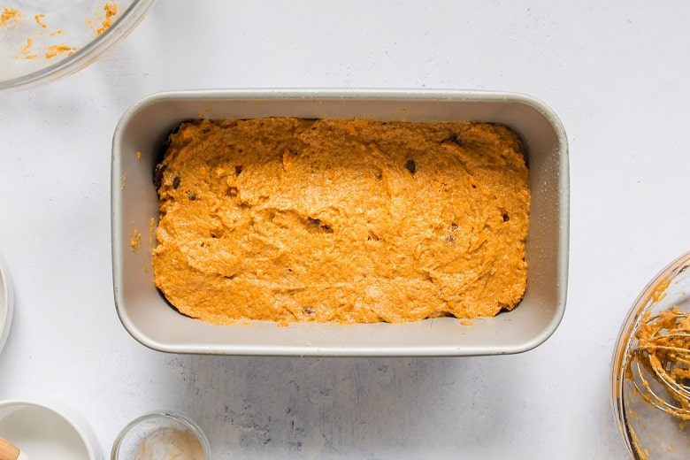Mixing bowl of wet ingredients for sweet potato bread on gray background | Bucket List Tummy