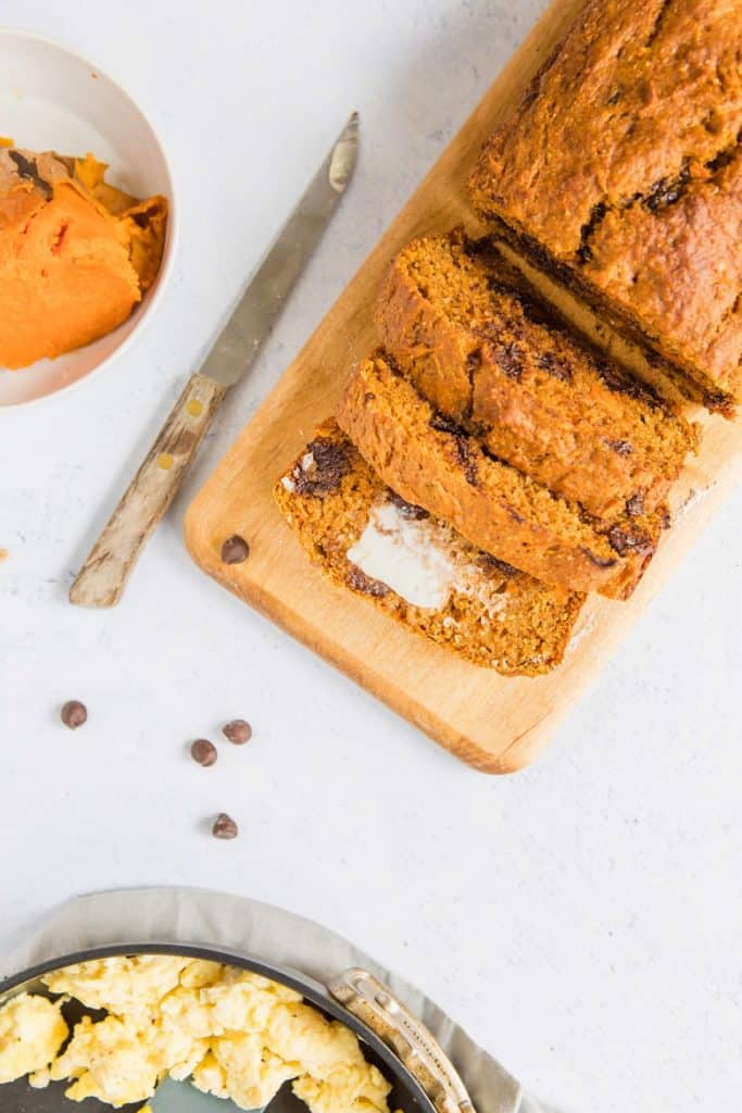 overhead view of homemade sweet potato quick bread recipe on white background