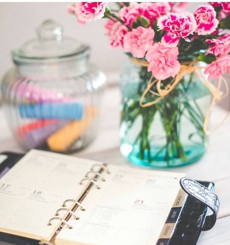 schedule on table with flowers