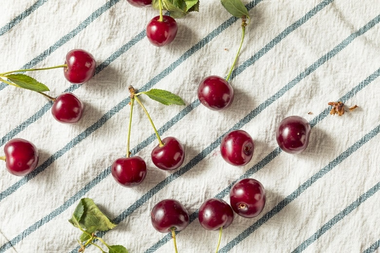 tart cherries on dish towel