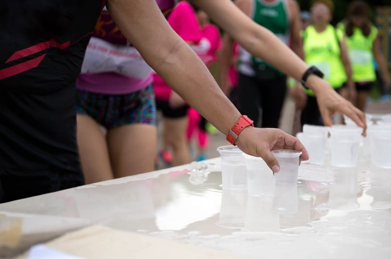 handing out water cups at marathon