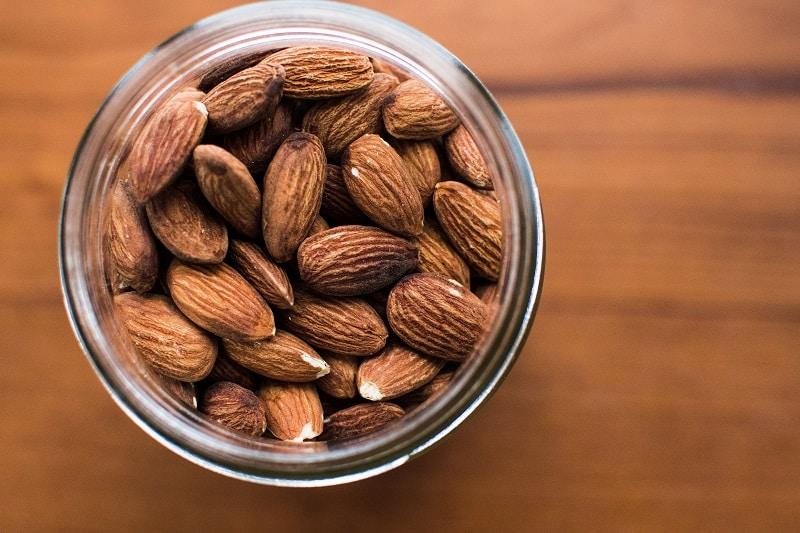closeup of almonds in clear glass