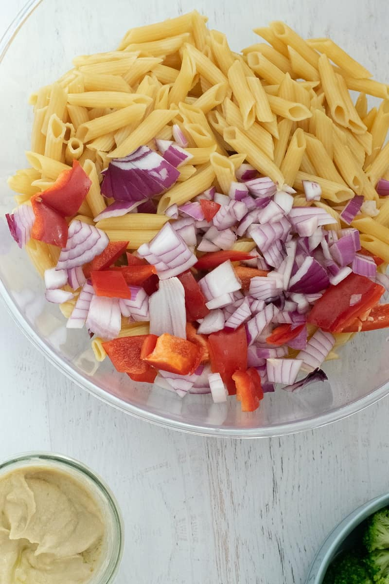 ingredients for pasta salad in clear bowl
