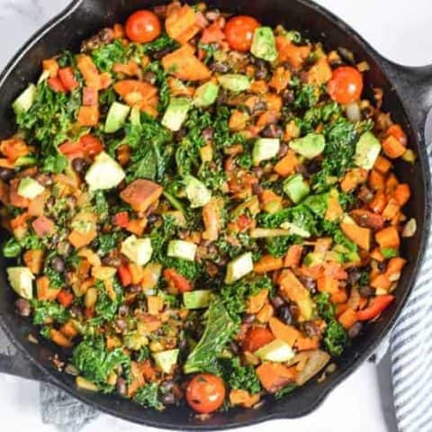 Sweet Potato Kale Hash in skillet on white countertop
