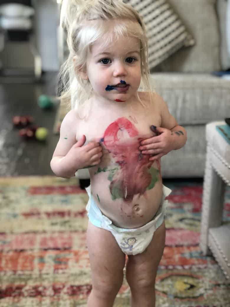 toddler playing with paint