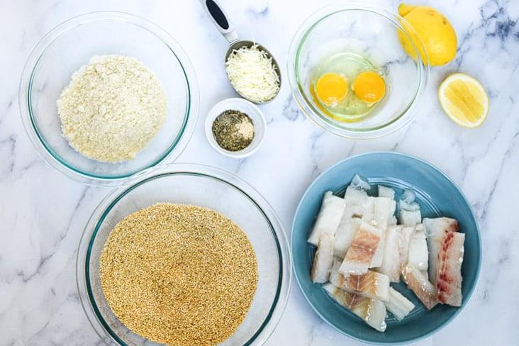 ingredients in bowls to make homemade fish sticks