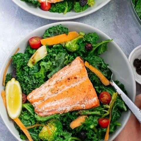 Broccoli Kale salad with Sockeye Salmon filet on gray bowl   Bucket List Tummy