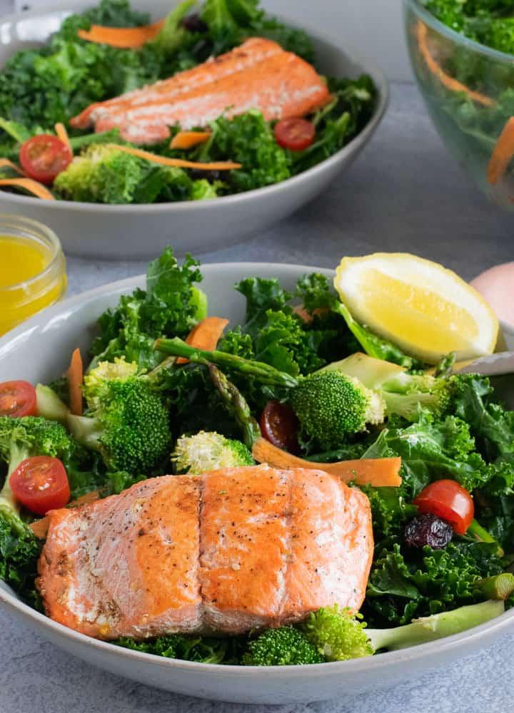 Broccoli and Kale salad with Sockeye Salmon filet on gray bowl   Bucket List Tummy
