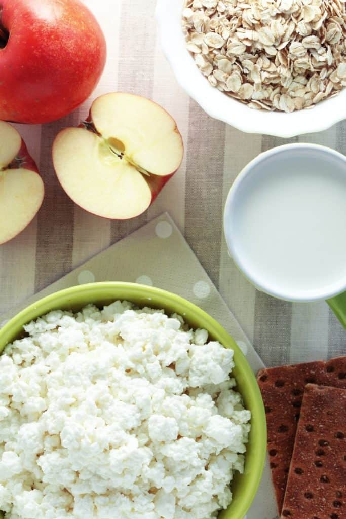 Breakfast of cottage cheese with oatmeal, apple and milk
