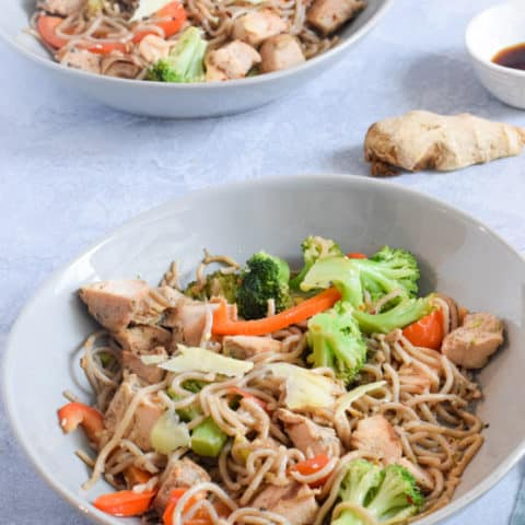 Egg Noodle Stir Fry in blue serving bowls | Bucket List Tummy
