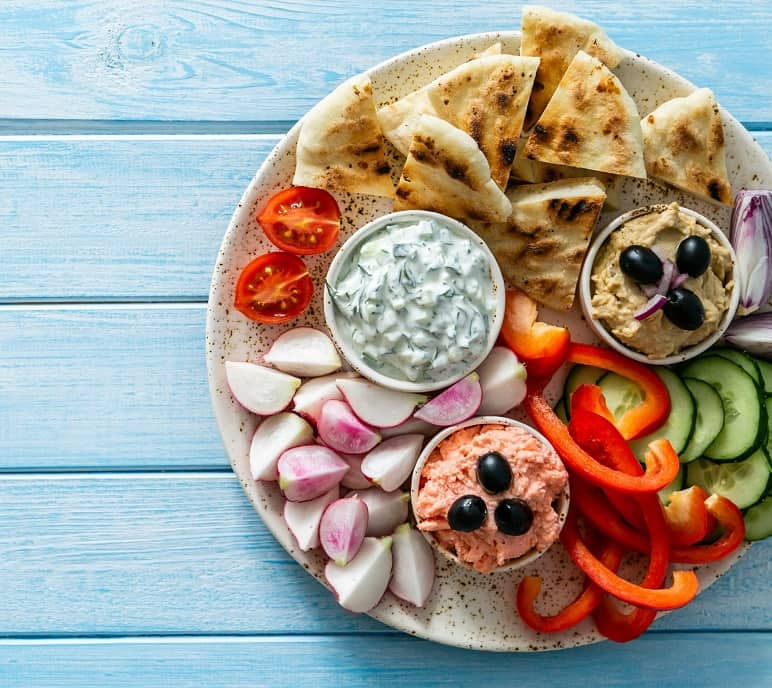 Appetizer plate of fruits, veggies and dips