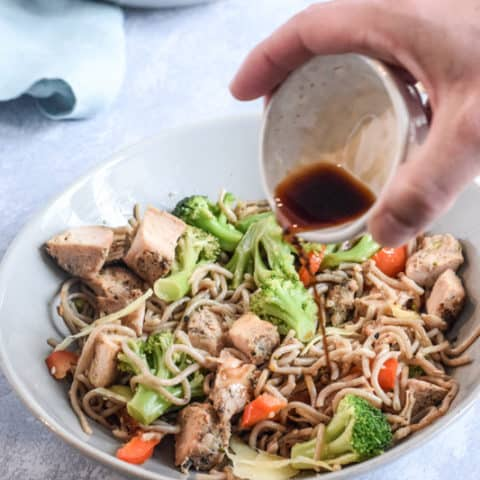 Pouring soy sauce over Stir fry egg noodles with chicken | Bucket List Tummy